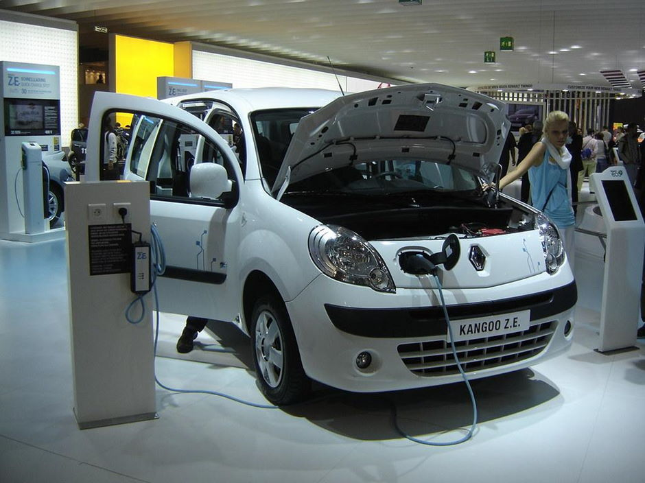 A Renault Kangoo Z.E connected to a charging station at an automotive exhibition