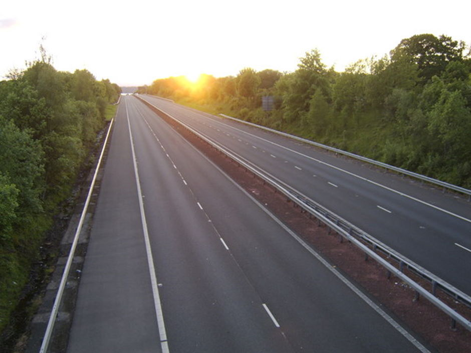 Sun setting over an empty motorway