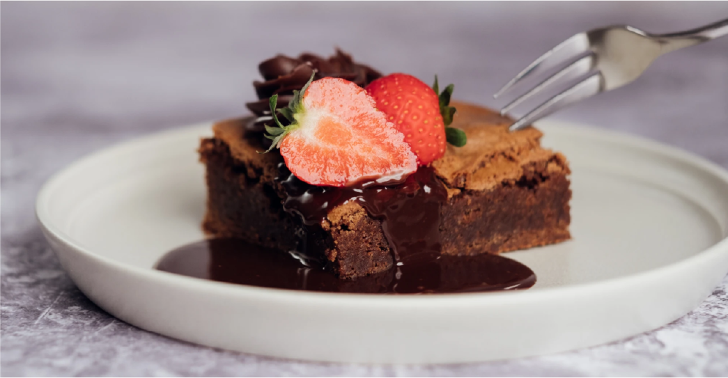 Chocolate brownie with a strawberry on top